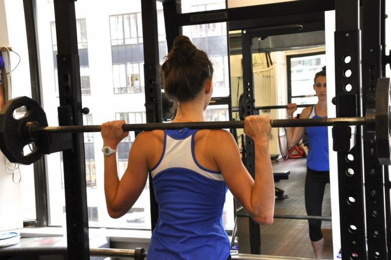 Racking the bar for back Squats - step under the bar and place it across the traps.