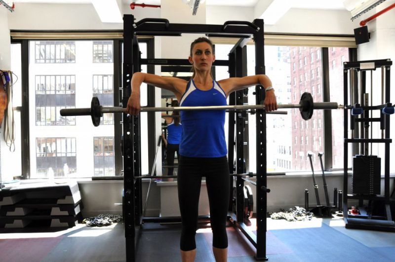 Snatch grip-width is a width that, when the bar is upright rowed to the midline of the chest, the forearms are perpendicular to the floor.