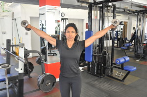 Standing-DB-Lateral-Raise-front-view-step-2-running-strength-training-New-York-City-personal-training